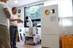 도심에서 폐PET병 분쇄하는 자판기 등장? 자판기형 폐PET병 저속분쇄기 시연회 열려